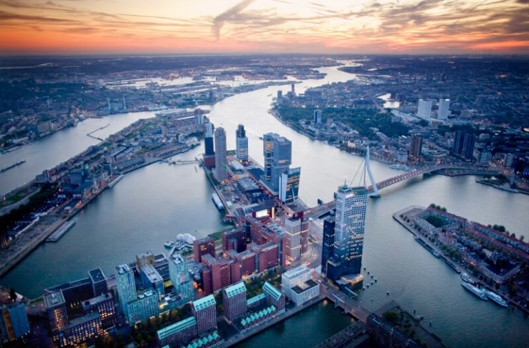 Rotterdam-overview-of-skyline-erasmusbrug-and-buildings-wilhelminapier-from-the-sky